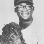 photo of dick allen in philadelphia phillies baseball uniform wearing baseball glove