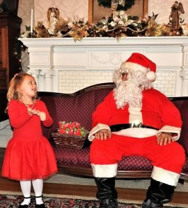 little girl talking with santa claus